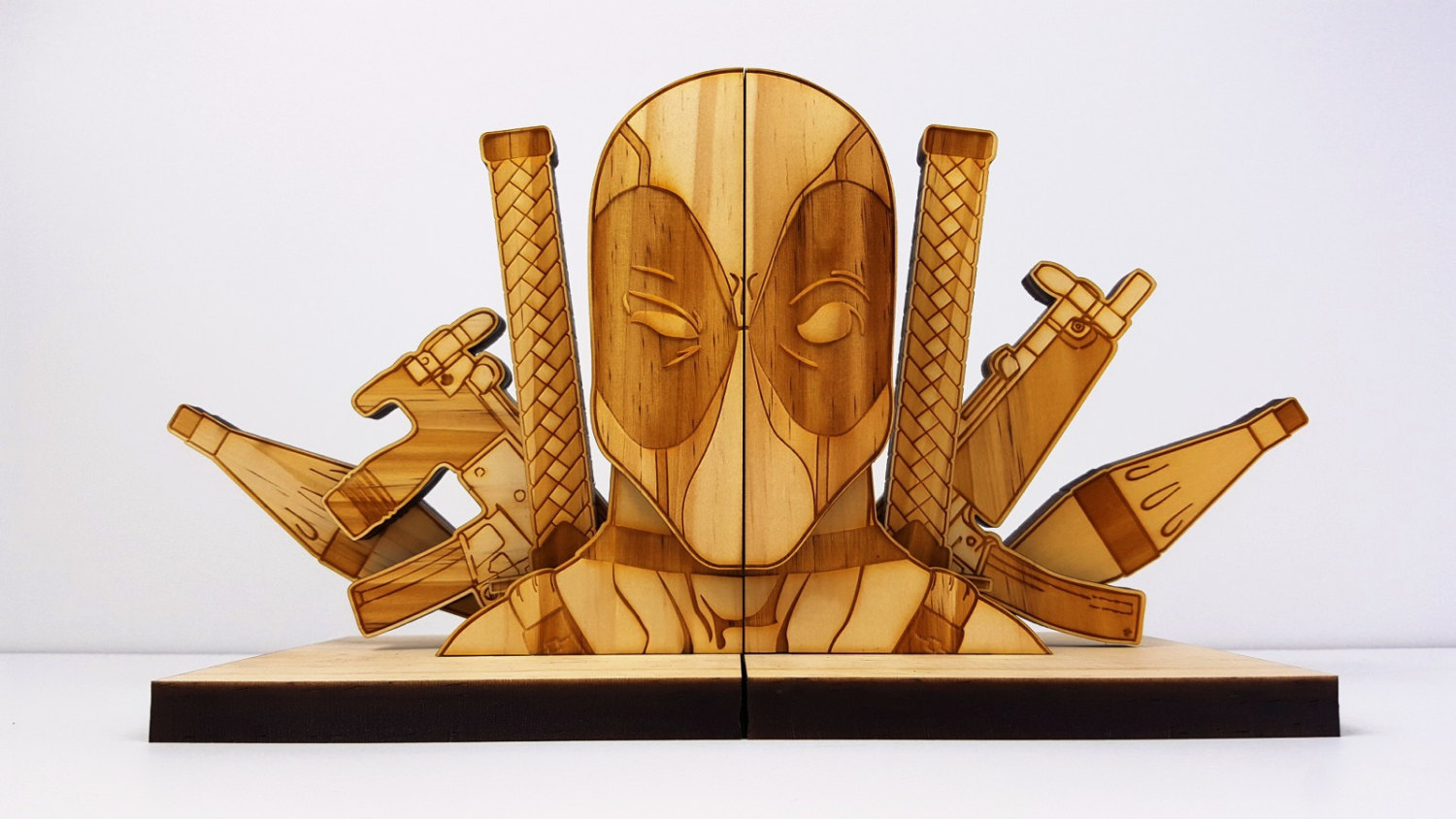 Online Home Decore Deadpool And Batman Bookends To Keep Your Rpgs Safe